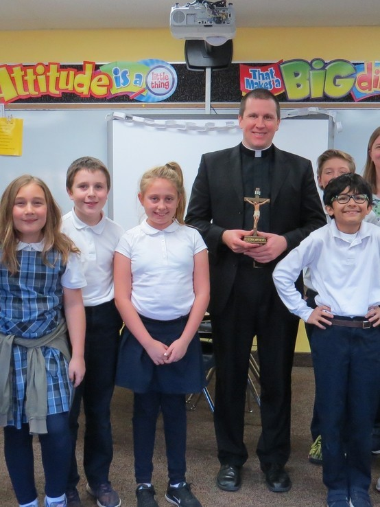 Fr. Bryce Evans with 5th Graders